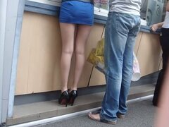 Hottie in miniskirt gets caught in a street candid clip, Really nice looking babe in blue miniskirt gets caught in this street candid voyeur video and it looks more than nice. Her legs are long and her butt seems to be quite fuckable and awesome.