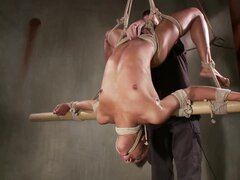 Tiied up ebony sub clamped pussy during their session
