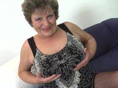 Golden dildo makes the big tits granny feel good - Carmela
