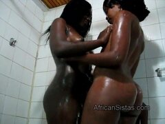 African sluts play with their pussies in the shower
